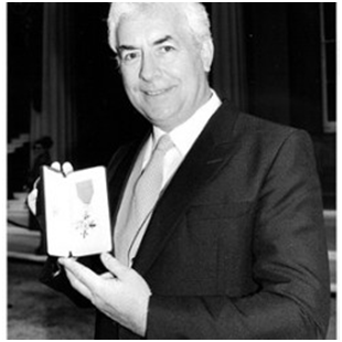 Ron Pickering receiving his OBE-Picture courtesy of the Ron Pickering Memorial Fund